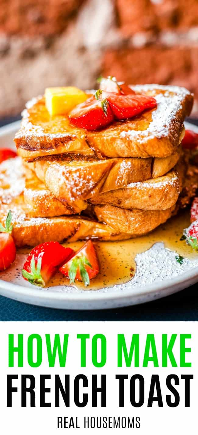 french toast piled up on a plate with powdered sugar and fruit