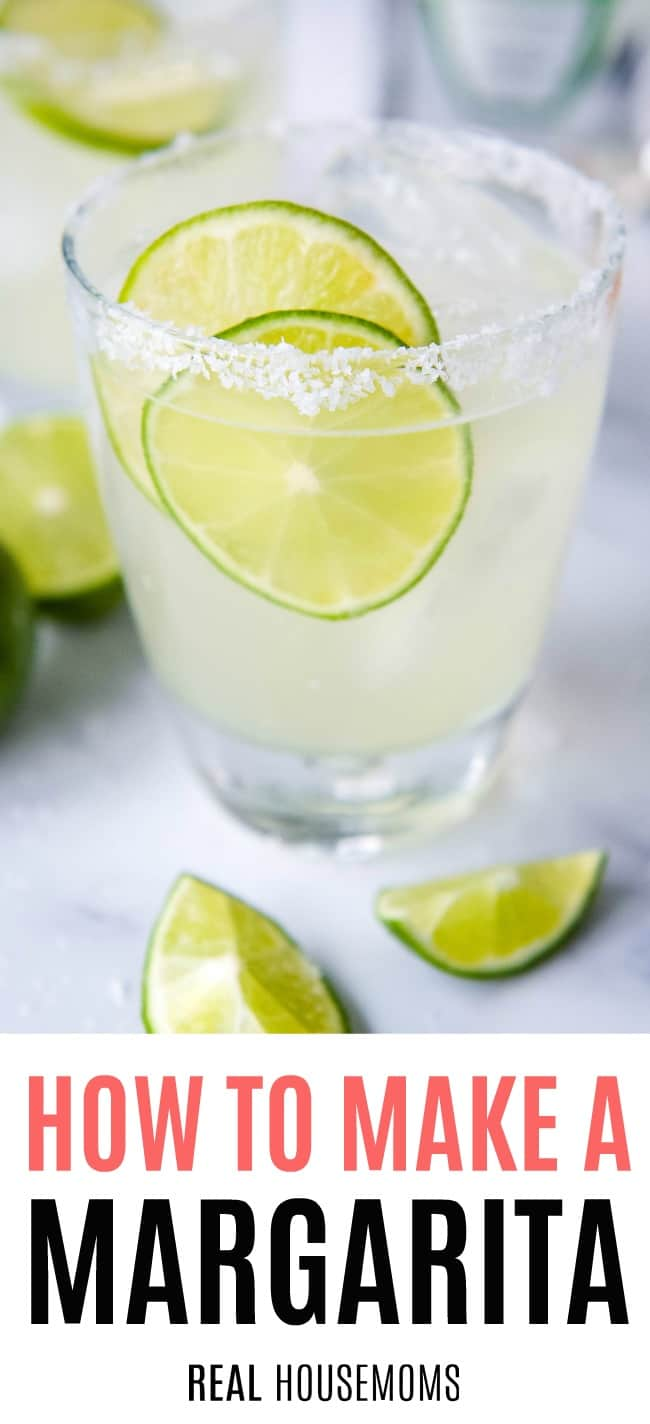 margarita in a rocks glass with ice and lime slices