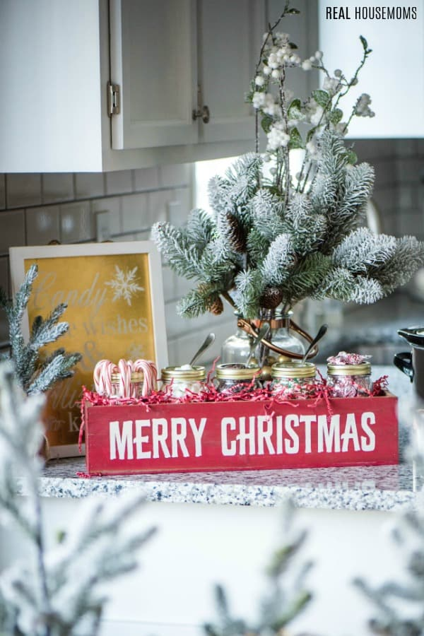 hot chocolate bar decorated with flocked pine trees