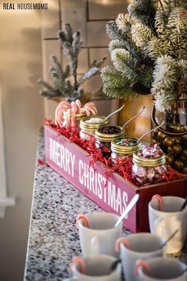 hot chocolate bar toppings next to mugs