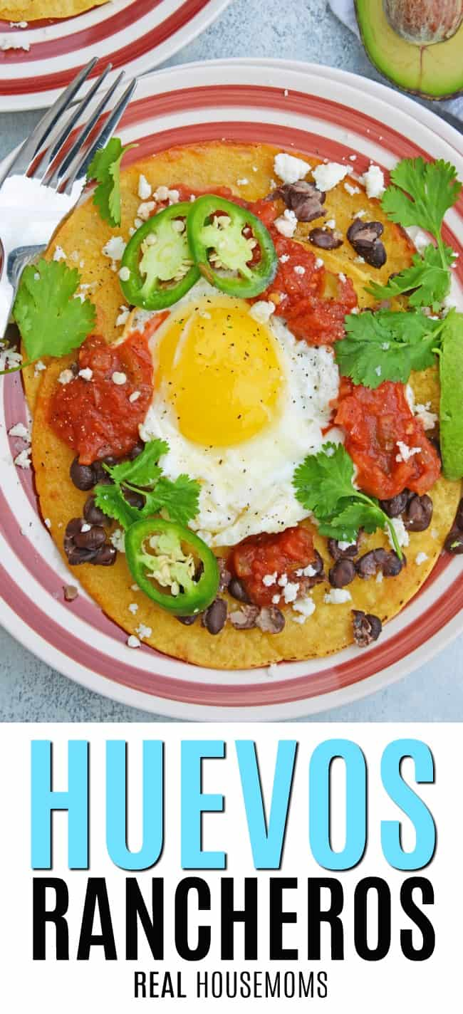 huevos rancheros on a plate with jalapeno and avocado
