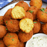 Hush Puppies are gently fried cornbread with a crunchy outside and soft, doughy inside. Serve with fish fry, fried shrimp or any BBQ!