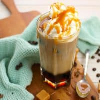 This Iced Caramel Macchiato recipe is the perfect iced coffee drink! Made with just a few simple ingredients, you'll quickly discover that you can make this coffee-house quality drink right at home!
