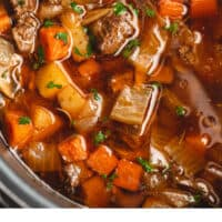 close up of instant pot beef stew in pot with recipe name at bottom
