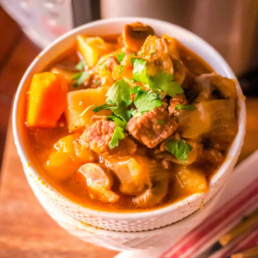 Perfect for winter dinners, this warm and hearty Instant Pot Beef Stew will become a family favorite! So easy to make and great for busy weeknights!