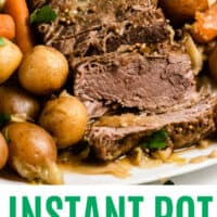 instant pot corned beef and cabbage ut itno slices on a platter with poatoes and carrots with recipe name at bottom