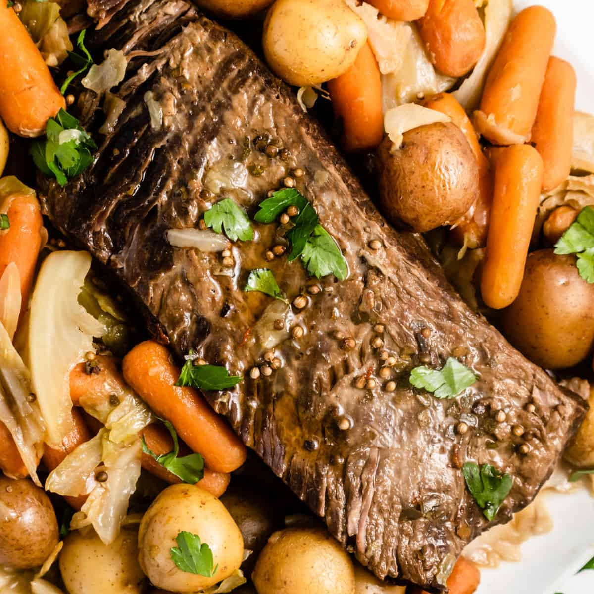 square image of instant pot corned beef and cabbage with poatoes and carrots