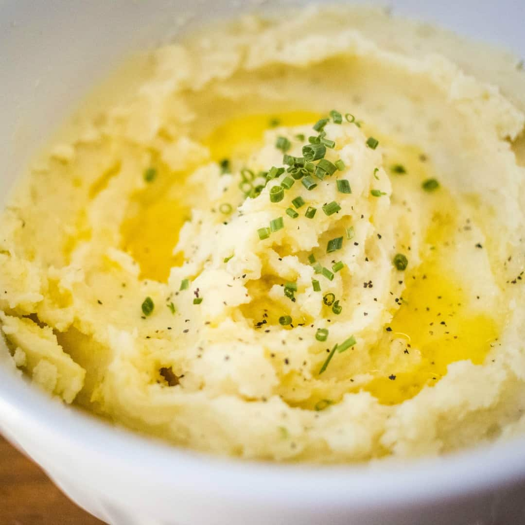Save time and energy in the kitchen by making these easy and delicious Instant Pot Mashed Potatoes! A family favorite great for weeknights or the holidays!