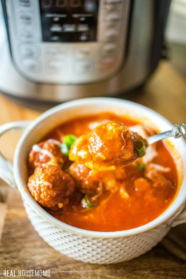 bowl and spoonful of instant pot meatball soup
