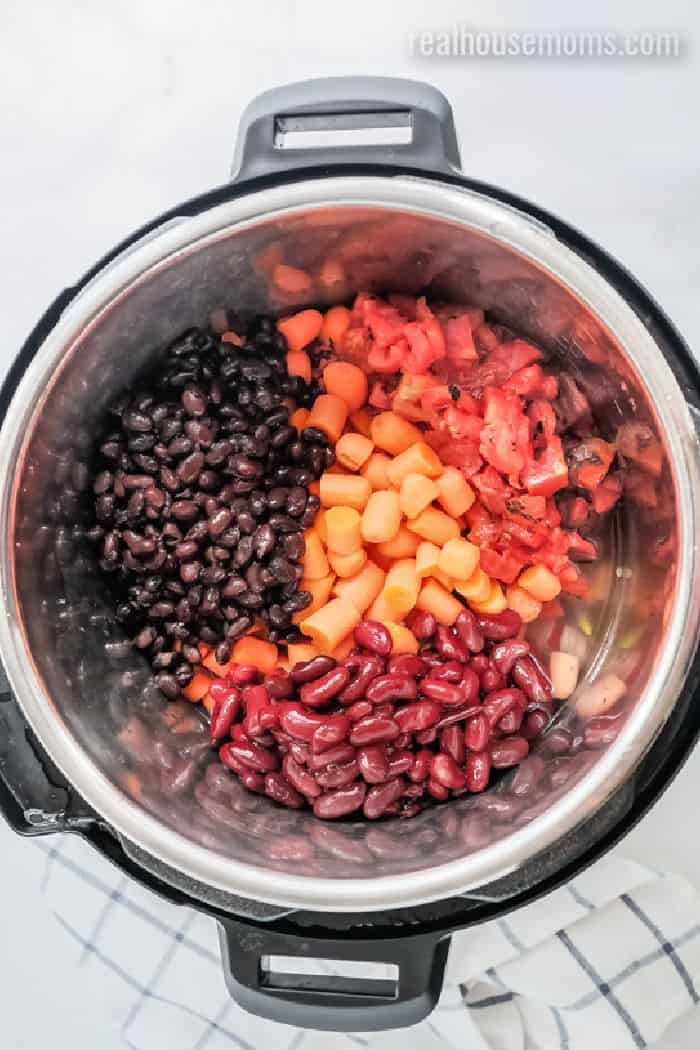 instant pot with carrots, beans and tomatoes
