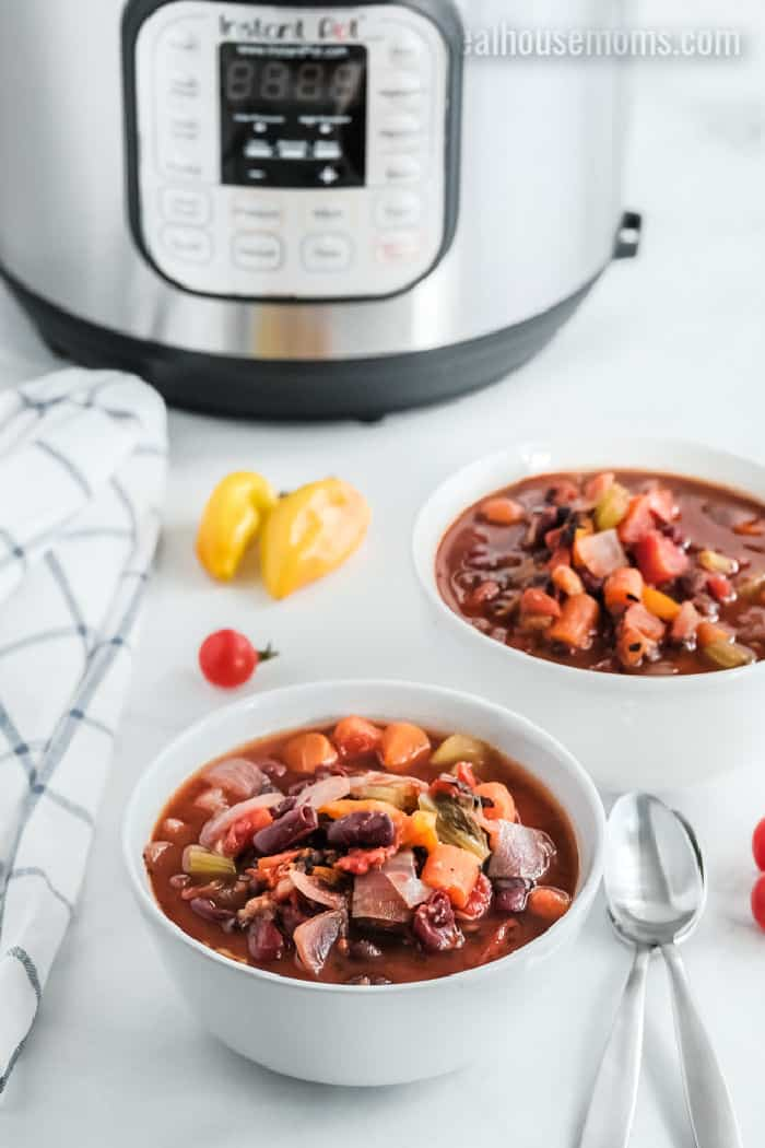 two bowls of vegetarian chili next to an instant pot