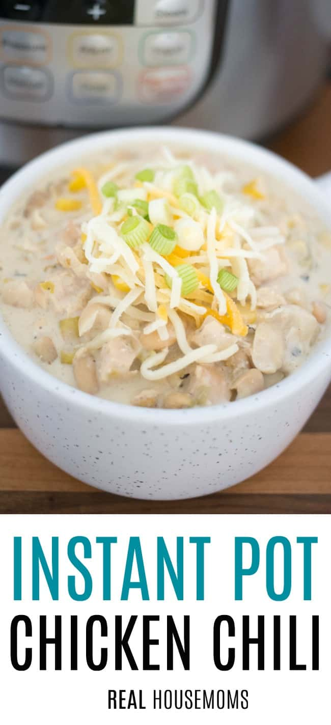 Instant Pot Chicken Chili served in a soup bowl topped with cheese and green onion