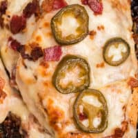 square close up image of jalapeno popper stuffed chicken in a skillet