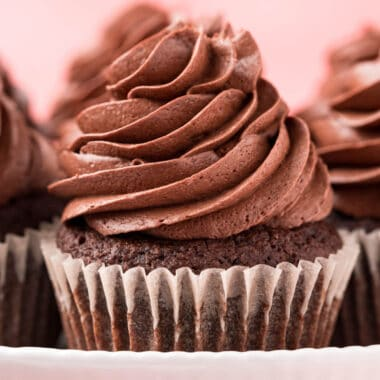 square close up image of keto chocolate cupcake on a cake stand