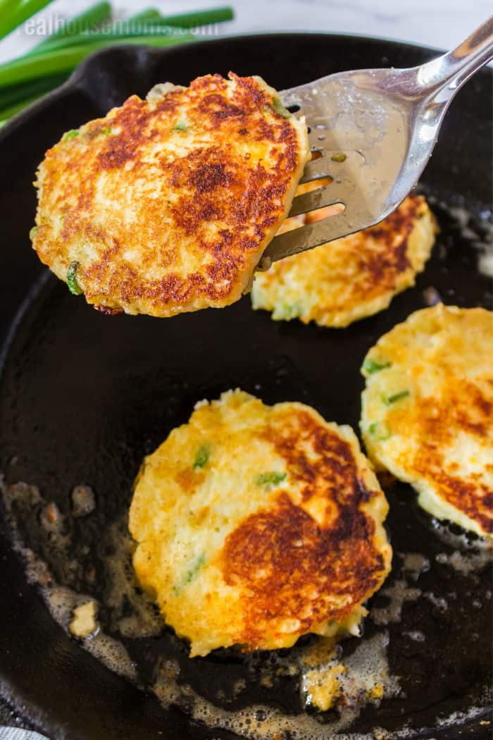 spatula lifting a mashed potato pancake out of a skillet