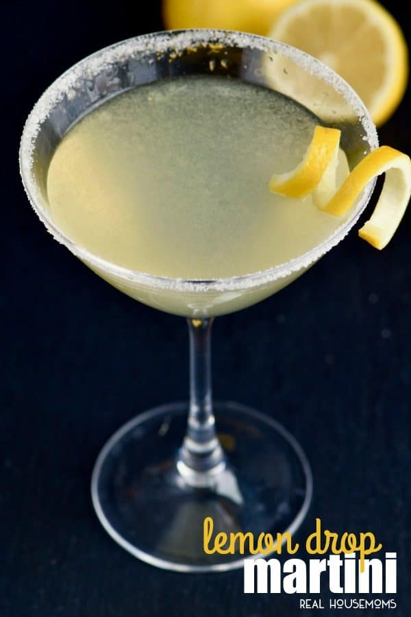 Looking down at a lemon drop martini garnish with a lemon twist