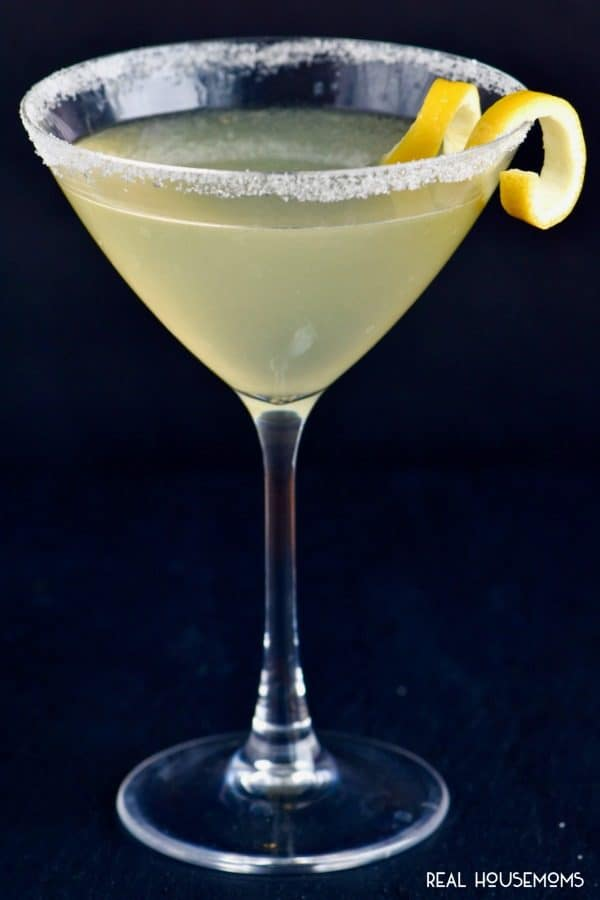 Lemon Drop Martini served in a martini glass rimmed in sugar and garnished with a lemon twist