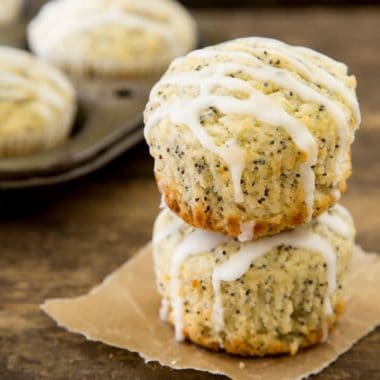 Lemon lovers pucker up with these LEMON POPPY SEED MUFFINS drizzled with lemon glaze. It's a flavor explosion in your mouth that is perfect for breakfast, brunch or just snacking!