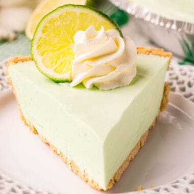 square image of Lime Jello Pie with cool whip and a lime slice on top