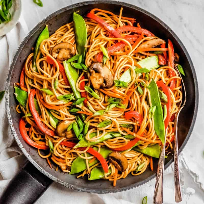 Lo Mein is such a delicious and easy healthy meal! This Asian noodle dish is loaded with veggies and you can have it on the table in less than 15 minutes!