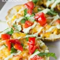 These baked LOADED MEXICAN POTATO SKINS are a fun appetizer that has loads of Mexican flavor to make you keep coming back for more!
