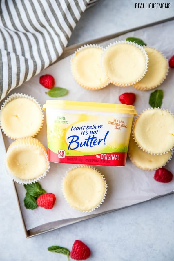 low carb cheesecake bites on a baking sheet with a tub of I Can't Believe It's Not Butter