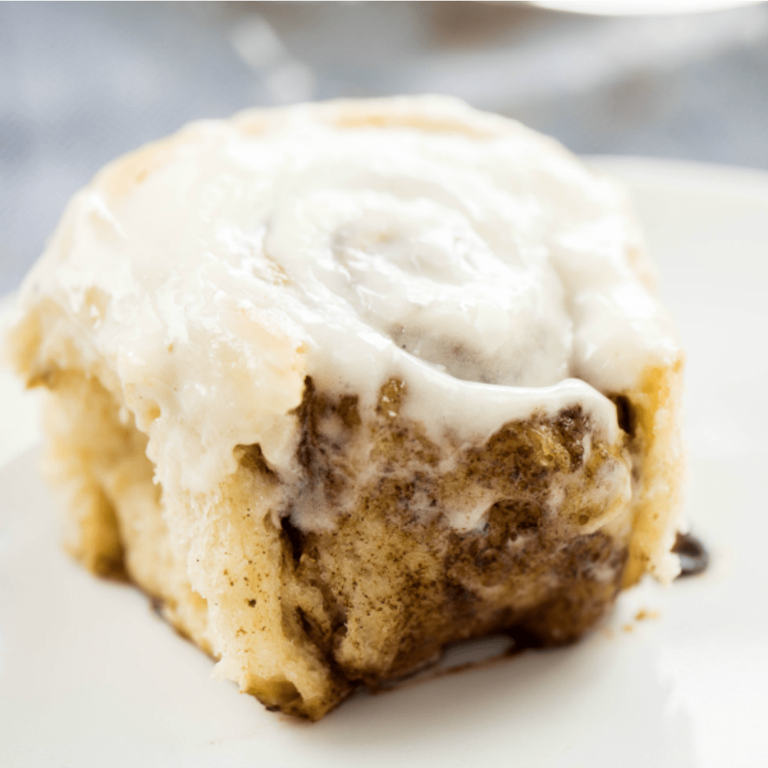 I used my Mamaw's roll recipe to make up the easiest cinnamon rolls of all time! These are big and fluffy! Full of cinnamon flavor and the perfect amount of warm frosting on top! Watch out Cinnabon!