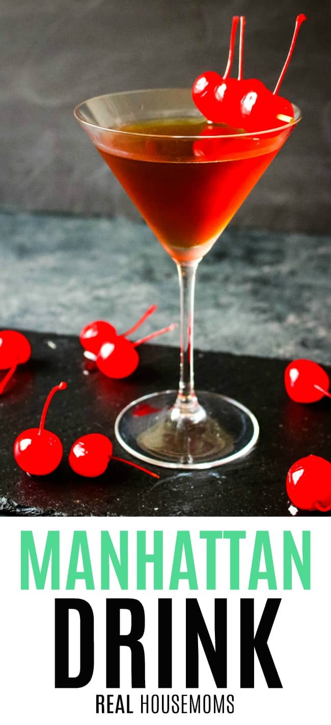 manhattan drink in a martini glass with cherries