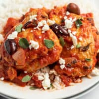 chicken thighs with red sauce, herbs, olives, and cheese