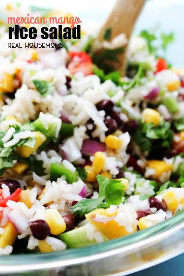 MEXICAN MANGO RICE SALAD is a fresh summer dish loaded with fresh veggies, mangoes then drizzled with a cumin vinaigrette. Easy, delicious and ready in 25-minutes!
