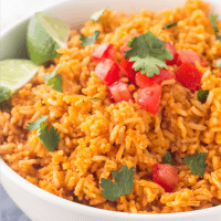 Easy, homemade Mexican Rice Recipe is the perfect side dish whenever you're making Mexican food. So delicious & just like your favorite Mexican restaurant!