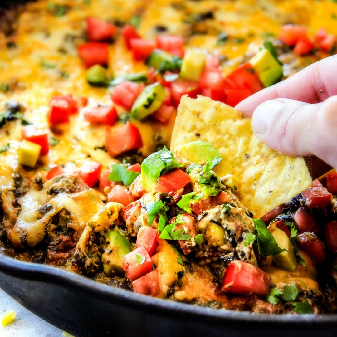 This warm and creamy Mexican Spinach Dip is easy, make ahead, bursting with fiestalicious spices and quite possibly the BEST Spinach Dip ever!
