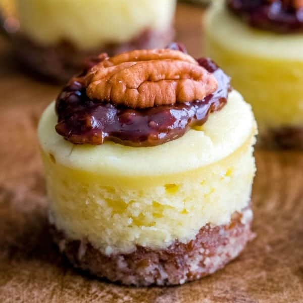 square image on a mini chocolate pecan pie cheesecake on a cutting board