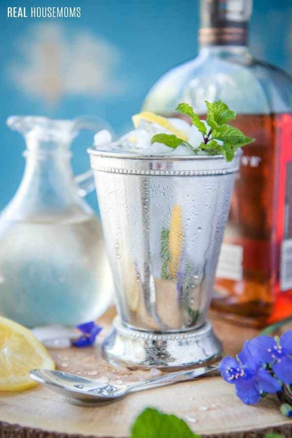 mint julep with a bottle of bourbon