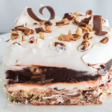 slice of mud pie topped with chocolate shavings and nuts