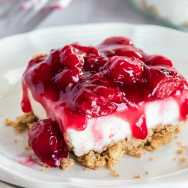 No Bake Cherry Cheesecake is ridiculously easy to make and a total crowd pleaser! Make a double batch and watch it fly off the pan!