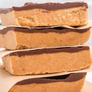 close up of 4 no bake chocolate & peanut butter bars stacked up