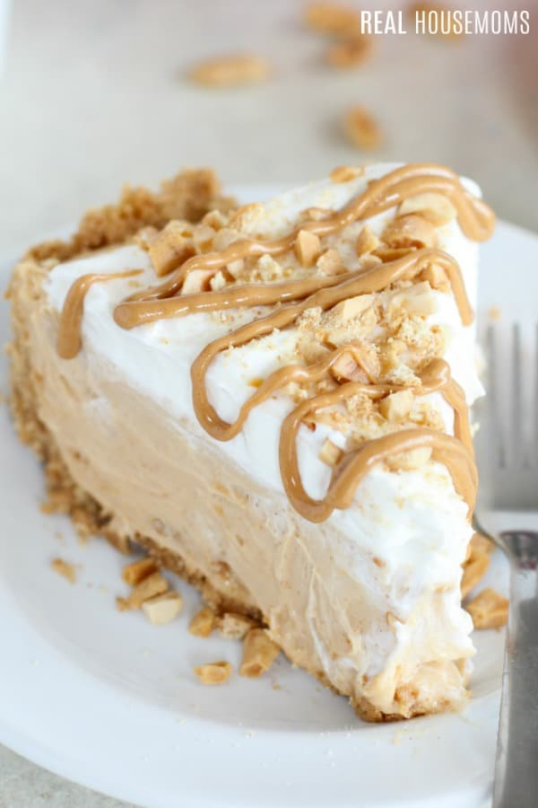 no bake peanut butter pie slice topped with melted peanut butter