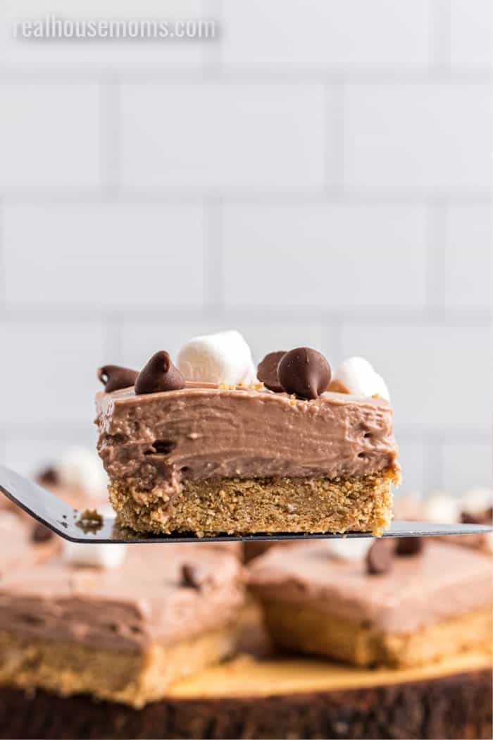 no bake cheesecake bar on a spatula