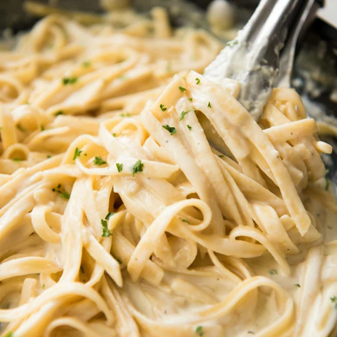 Yes, you CAN make a creamy alfredo pasta in ONE POT! You'll be blown away how good this One Pot Alfredo Pasta is - the pasta is evenly cooked, the sauce is silky and creamy, not gluggy and thick. This is a game changer!!