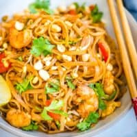 Pad Thai is a one-pot dish made with flat rice noodles, chicken or shrimp, bean sprouts, and a sweet-savory sauce. It's healthy and easy to make!