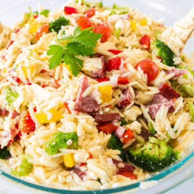 Orzo Pasta Salad is one of the tastiest and easiest summer sides! I love the color and fresh veggies mixed together with the little grains of orzo pasta!