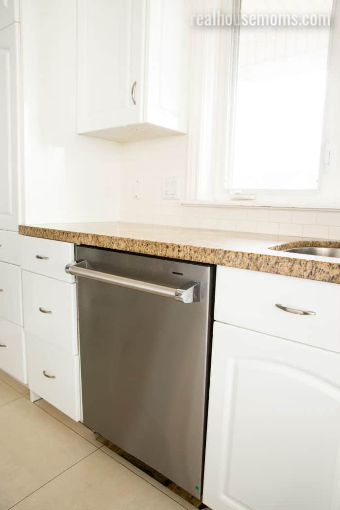 Beko dishwasher installed in a ktichen with white cabinets and quartz counter tops