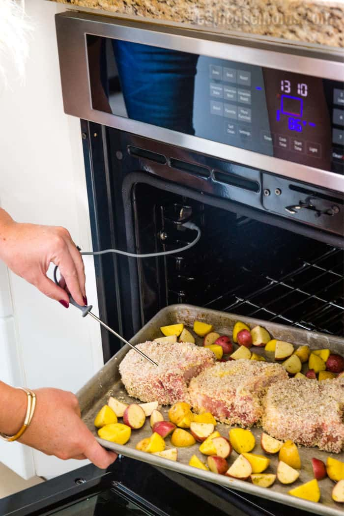 woman using probe thermometer attachment in Beko built in wall oven