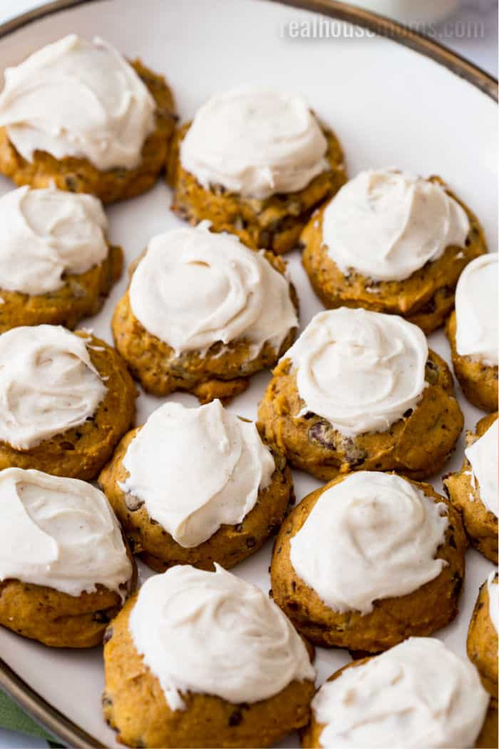 frosted pumpkin cookies on a platter