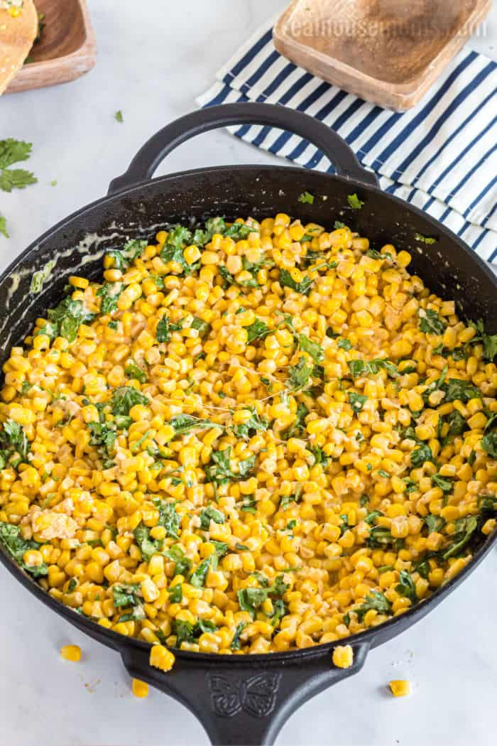 parmesan corn with cilantro in a skillet
