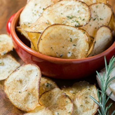 Taking a simple potato & making it into a delicious snack is easier than you think. These crispy PARMESAN ROSEMARY POTATO CHIPS are a loaded with flavor!