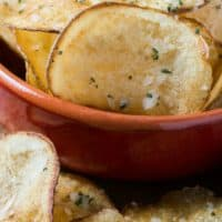 Taking a simple potato and making it easily into a delicious snack is easier than you think. These crispy PARMESAN ROSEMARY POTATO CHIPS are a masterpiece of flavor!