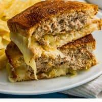 close up of patty melt sandwich on a dinner plate