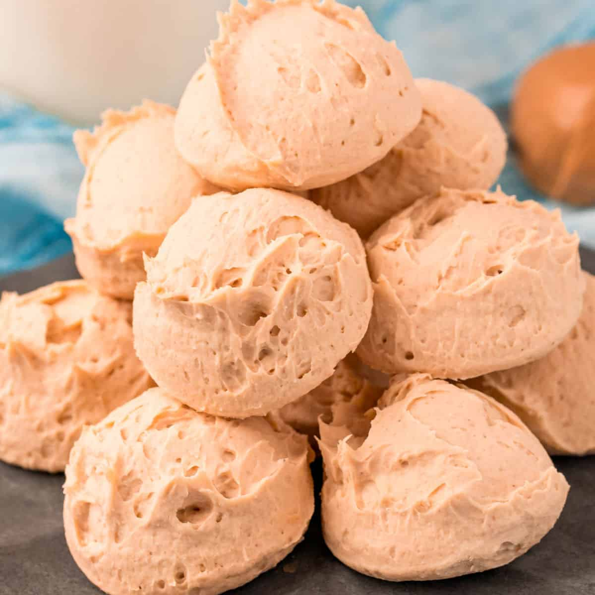 square image of peanut butter cheesecake fat bombs piled on a plate